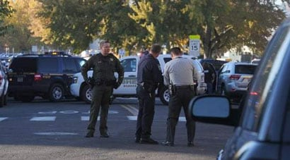 Police gather at Sparks Middle School just outside of Reno this morning after a student opened fired, injuring two and killing a teacher before turning the gun on himself. (Photo credit: Reno Gazette-Journal)