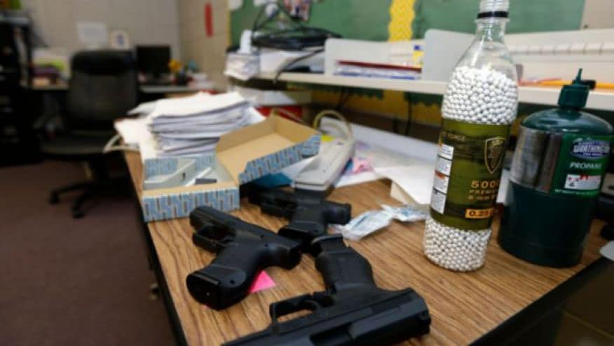Arkansas' Clarksville School District offered its teachers an intense 53-hour training program, which included active shooter scenarios, using airsoft guns for training. While some parents were happy with the idea of armed teachers, other parents removed their children from the school. (Photo credit: Associated Press)