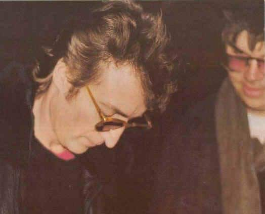 John Lennon signs and autograph for Mark Chapman
