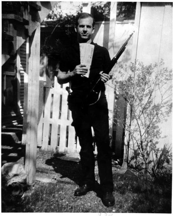 Lee Harvey Oswald with rifle