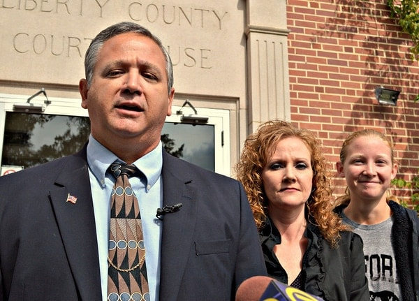 Liberty County Sheriff Nick Finch speaks on the Liberty County Courthouse steps Thursday after his acquittal. His wife Angela and daughter Amber, 16, stand with Finch. (Photo credit: Bill Cotterell, The Florida Current).