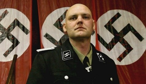 Joseph's father, Jeffery Hall, was a local leader of the National Socialist Movement and had a meeting of the group in his home the day before he was shot.