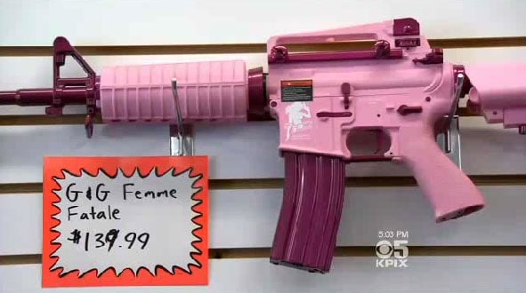 With brightly colored pink guns being all the rage among some women, it's hard to say that toy guns donning the same bright colors would distinguish them as such. (Photo credit: Chicago Tribune)