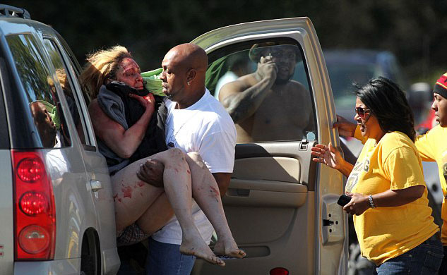 Marcus Arceneaux carries his niece, Bethany, after she was kidnapped and stabbed. (Photo credit: AP)