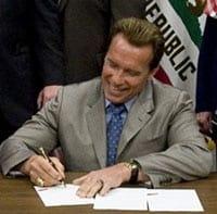 Gov. Arnold Schwarzenegger signing a bill into law.