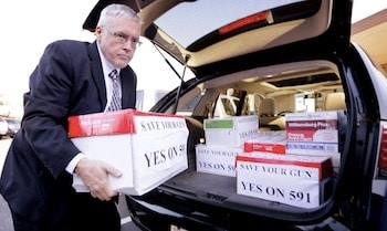 Ray Carter, executive director of Washington Arms Collectors, helping to deliver signatures for I-591.  (Photo Credit: Elaine Thompson / AP)