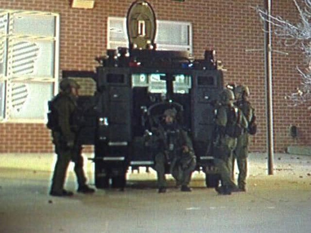 The responding team included a police helicopter, which spotlighted the school the in the early morning hours. (Photo credit: ABC Denver)