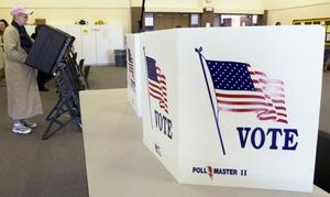 According to the Attorney General, some Kansas voters will be allowed to pack heat at the polls. (Photo credit: The Wichita Eagle)