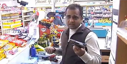The fed up owner shows reporters the gun he purchased to keep behind the counter at the store. (Photo credit: ABC)