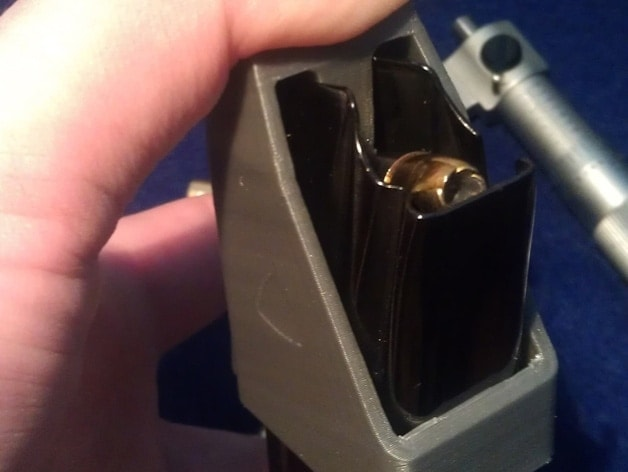 A speed reloader for a semi-automatic handgun magazine. (Photo credit: Thingverse.com)