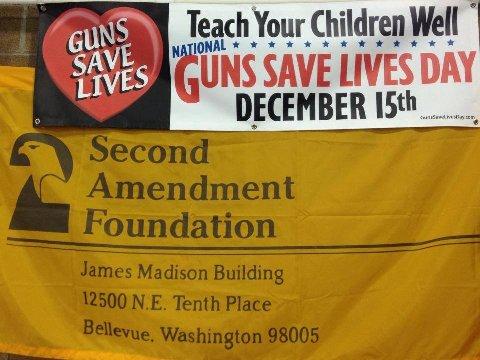 A 'Guns Save Lives Day' banner from a Washington state gun show.  (Photo Credit: Alan Gottlieb)