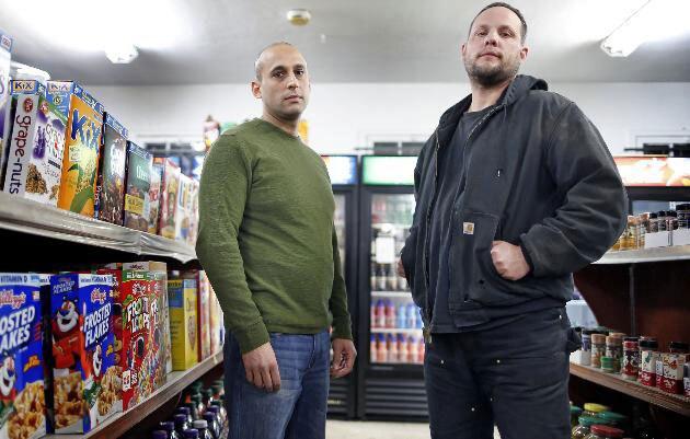 Store owner Mohamed Ahmed (L) and armed citizen Matt Dosser (R). (Photo credit: Star Tribune)