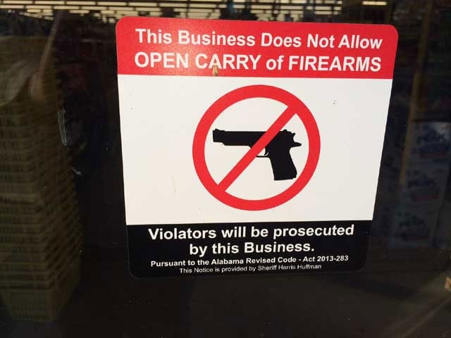 The suspect walked into the Dollar General waving a gun, ignoring the sign which prohibited him from doing so. (Photo credit: ABC)