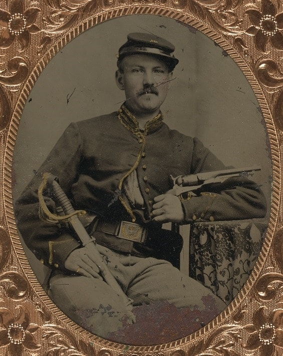 The gun used in the exampled drawing was a blackpowder Colt such as the one seen with this Civil War soldier. Made from the 1830s to the 1880s, these were the most common handguns of the age and Texas was no doubt awash with these revolvers at the time of Williams invention. (Photo credit: Library of Congress)