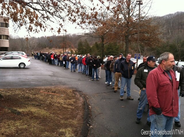 Connecticut residents waiting in a long line to register their assault weapons