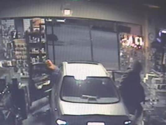Survillence footage from the store shows the burglars, complete with stolen Honda, inside the store. (The damage to the store, combined with the lost guns, amounted to an estimated $70,000. (Photo credit: AR Bunker)