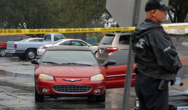 According to an account by one witness, one of the brothers was beating, kicking and stomping on a man seated at the driver's side of the car before the gunshots rang out. (Photo credit: Florida Today)