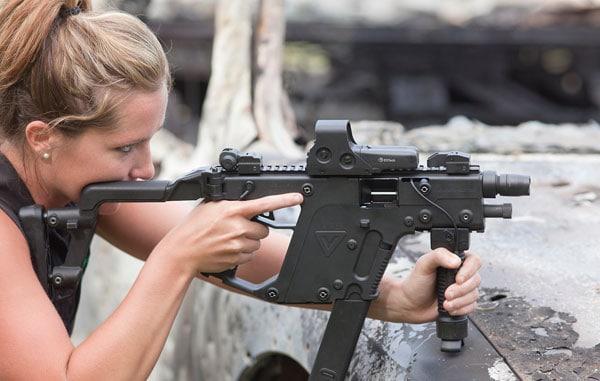 female shooting KRISS Super V