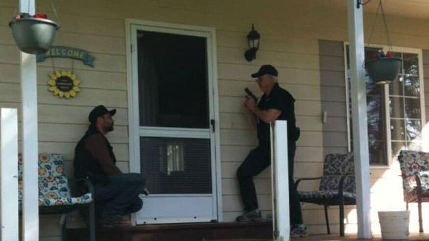 Members of the North Valley Community Watch check on a home in Josephine County. (Photo credit: Fox)