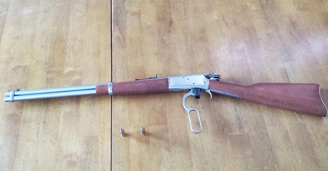 rossi rifle on wood floor