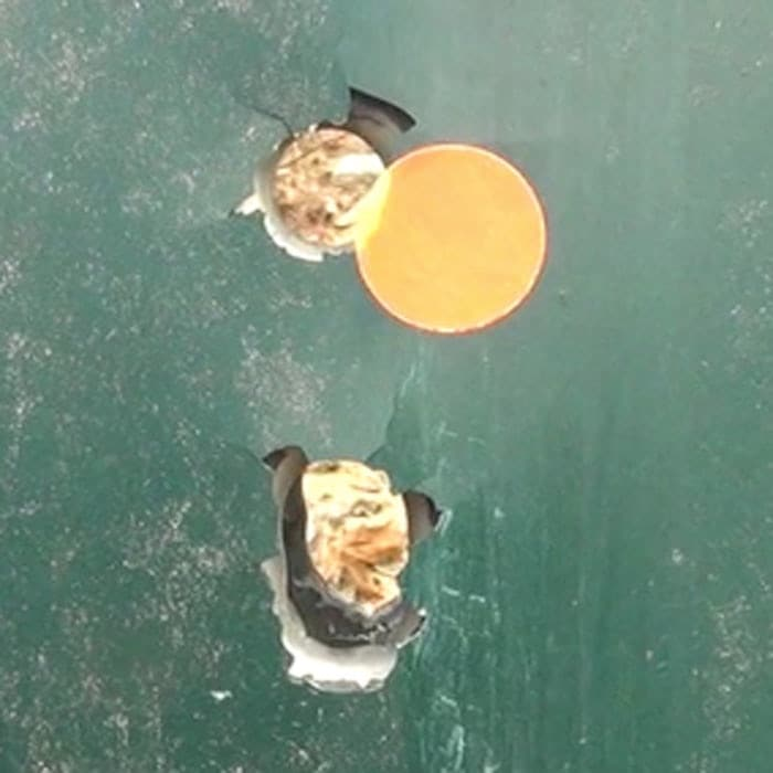 Accuracy?  The first shot clipped the dot.  The next three went in the same hole.  (Photo by David Higginbotham)