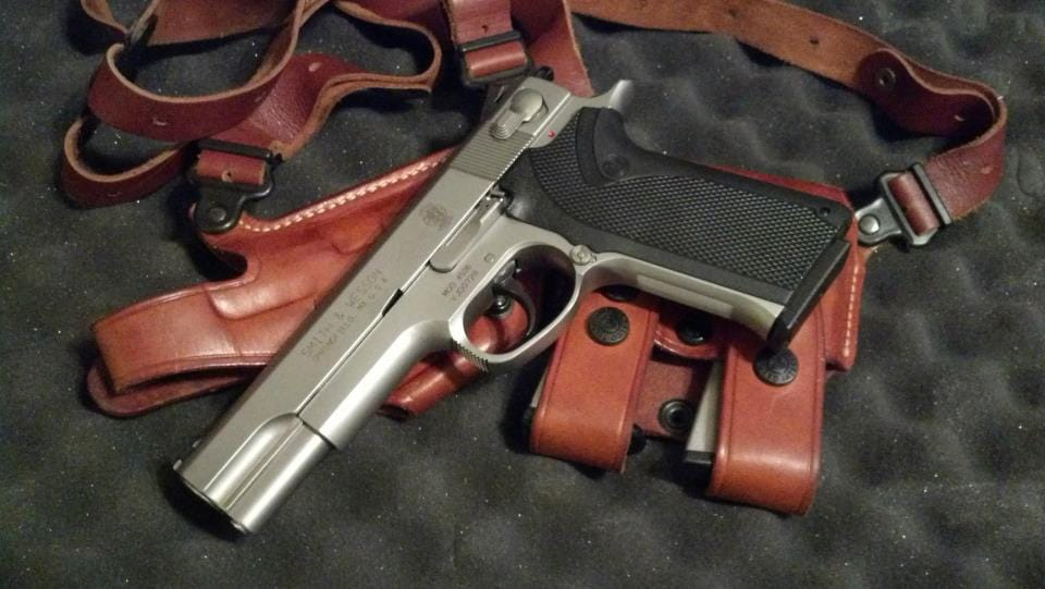 Smith 4506 with leather holster