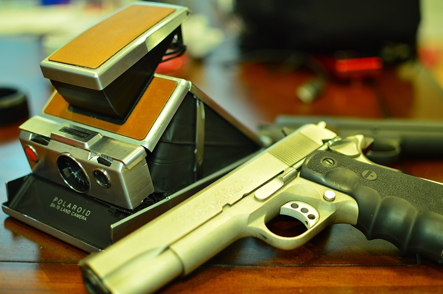 A series 70 Colt 1911 shown next to other cutting edge technology from the 70's (Photo by: Jim Grant)