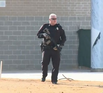 Students said that when they started to emerge from their classrooms and saw the officers outside armed with assault rifles, they knew that the lockdown was no ordinary drill. (Photo credit: NBC)