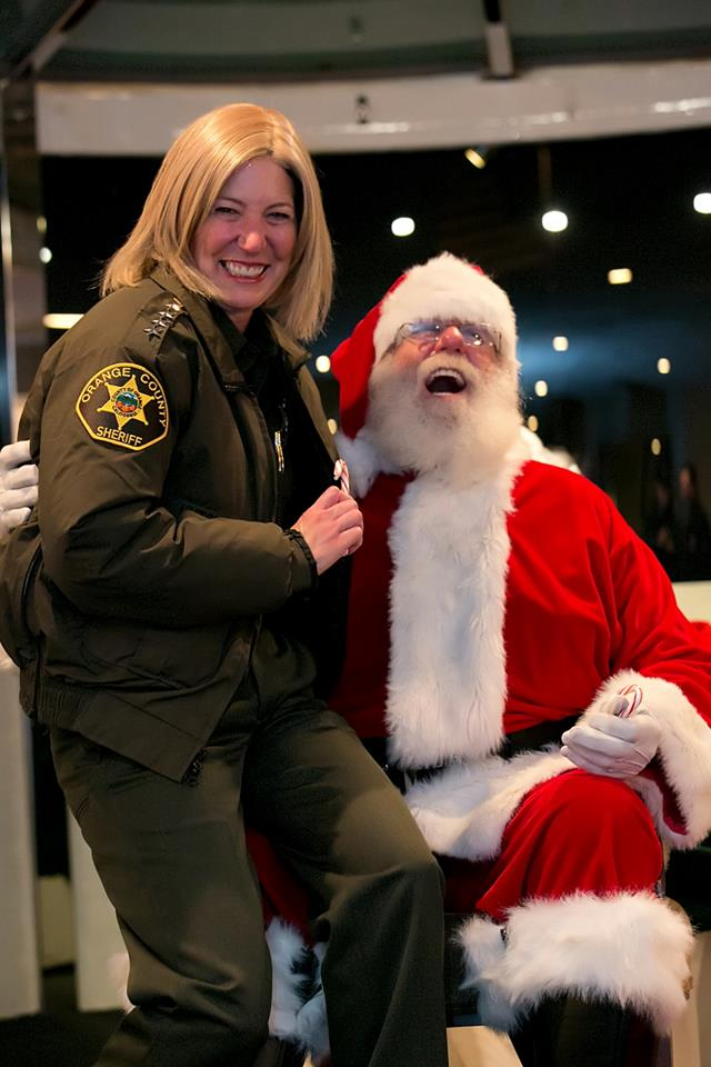 It's like Christmas in February as Orange County Sheriff-Coroner Sandra Hutchens is celebrating the recent Peruta decision by switching from may issue to shall-issue in the OC. (Photo credit: OCSD Facebook page https://www.facebook.com/OCSheriff/photos/pb.93196209677.-2207520000.1393029167./10151934335444678/?type=3&theater )