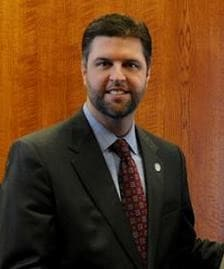"""""""I know of instances where people have owned and possessed a gun but had to wait up to 90 days to receive a permit from the state""""  says Sen Jared Carpenter, sponsor of SB106 (Photo credit: Facebook)"""