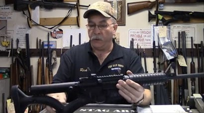 Rich Sehlmeyer, owner of The Gun Shop, in Lake Luzerne, N.Y., shows off a NY SAFE Act compliant AR-15. (Photo credit: Times Union of Albany)