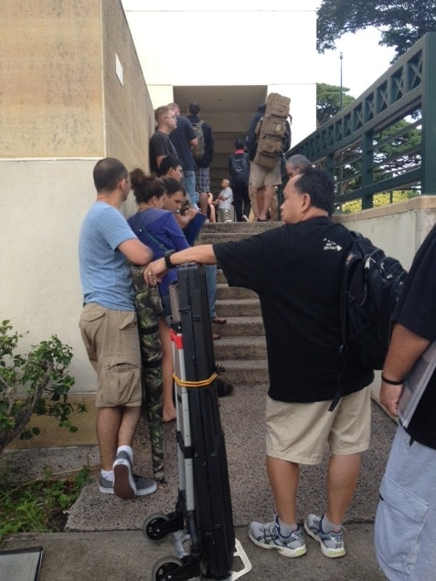 Lines at Hawaii police stations for those looking to register guns, required in the state since 1994, often take hours and mean extensive waits such as this one at the Honolulu Police Department recently (Photo credit: The Hawaii Reporter)
