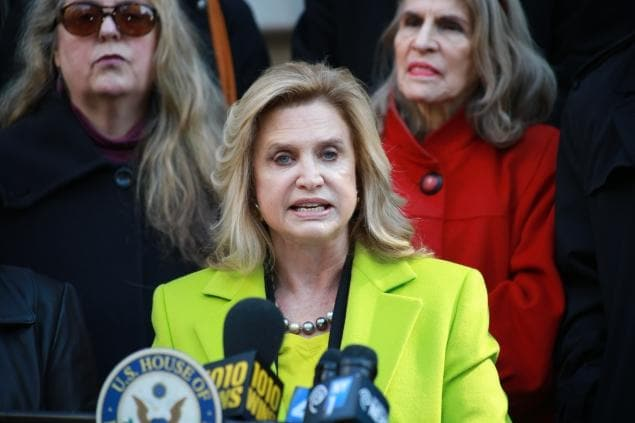 Rep. Carolyn Maloney on the steps of NY City hall Saturday speaking of her letter asking for $10 million in gun-study money (Photo credit: Shawn Inglima/NY Daily News)