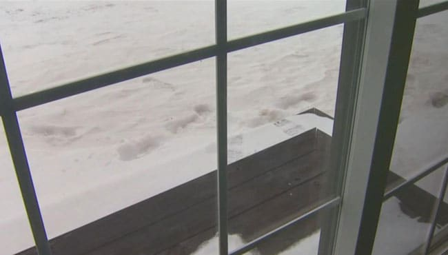 Footprints in the snow: A creepy reminder of the early-morning incident. (Photo credit: Wood TV 8)