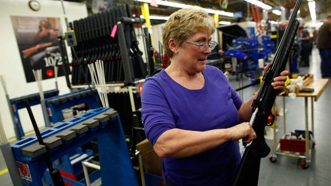Worker Marilyn MacKay assembles a rifle at the Sturm, Ruger & Co., Inc. gun factory in Newport, New Hampshire. (Photo credit: Reuters)