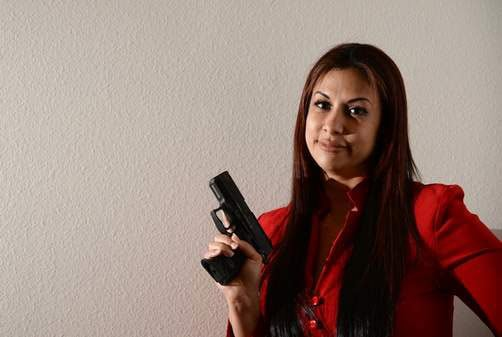 Ivette Ros says she carries her 9mm for safety, to protect herself, her three children and her employees while at work. (Photo credit: The Tampa Tribune)