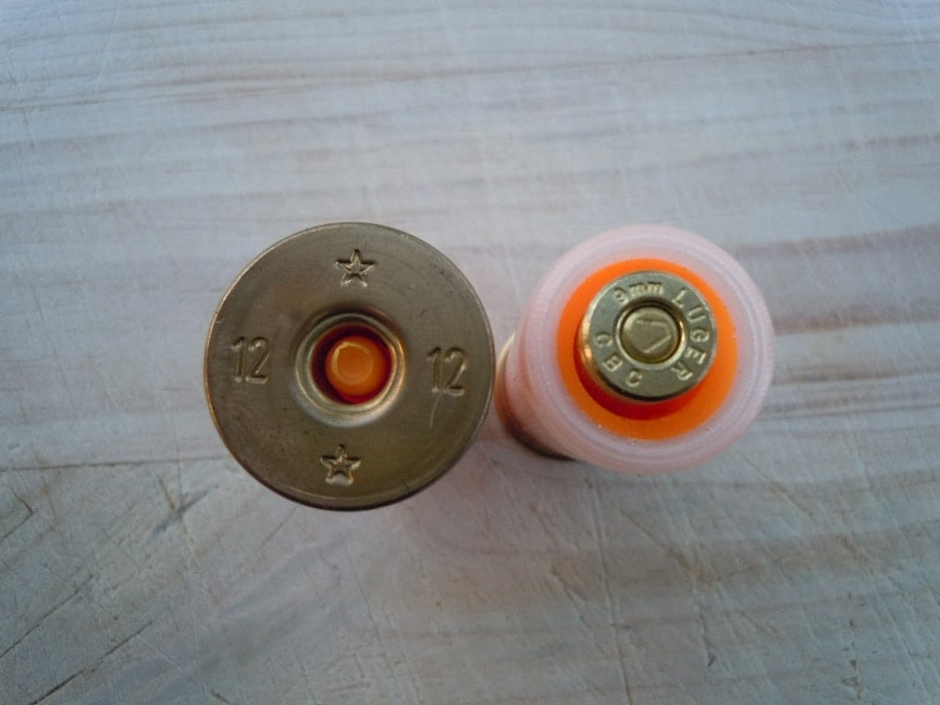 Once the breech is opened, rounds are loaded into the two-shot tubular magazine. You can see the orange striker trigger where the primer would be on a normal shotgun shell. (Photo credit: Beatus April stulti)