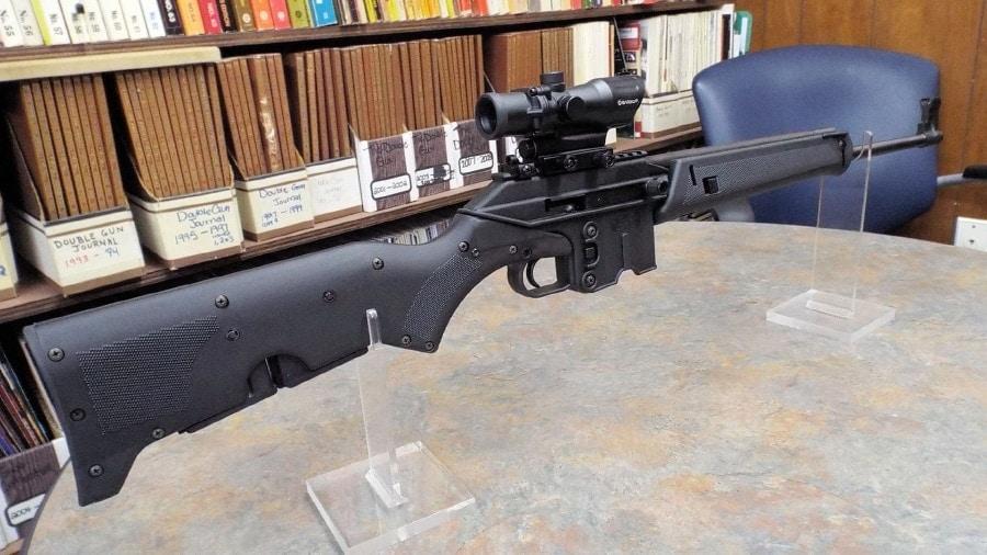 kel-tec su16 rifle on table in library