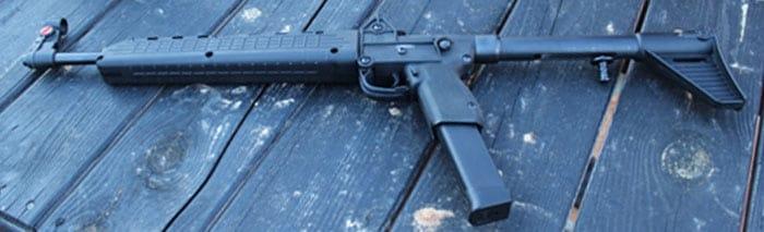 kel tec sub 2000 gun on wood table outdoors