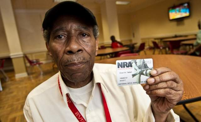 Oliver Talbert, 74, who lives in the Wilmington Housing Authority's Park View complex, displays his NRA membership card. He got it about a year ago when a friend of his was killed in a home invasion. (Photo credit: Robert Craig, The News Journal)
