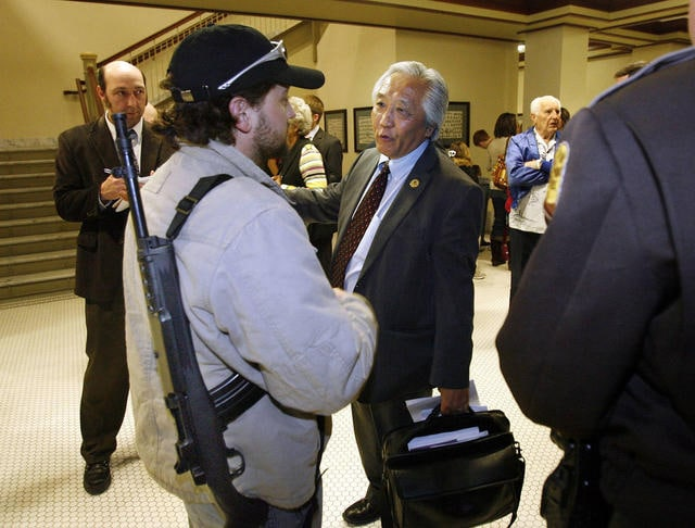Rep. Curt Oda speaking with Mathew Chappell who open carries his rifle as following a meeting concerning gun legislation at the Utah Capitol in Salt Lake City (Photo credit: Ravell Call, The Deseret News)