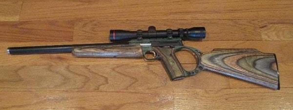 Buck Mark rifle on wooden table