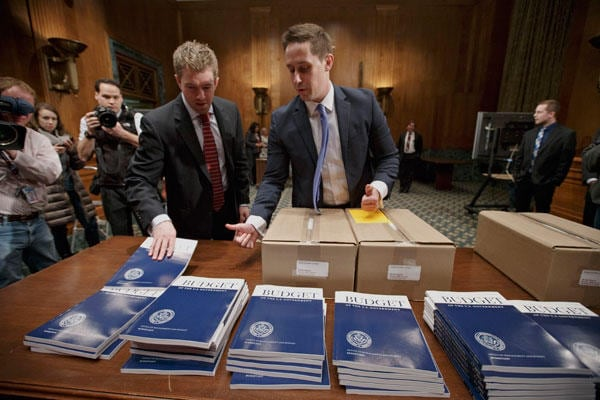 The President's $3.9 Trillion federal budget, seen here being distributed Tuesday to Congress, asks for $182 million to prevent 'gun violence'. (Photo credit: AP)