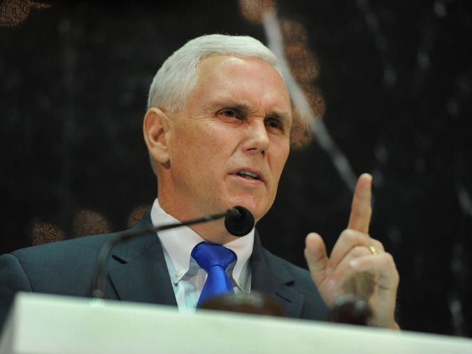 Gov. Mike Pence (R) expanded gun rights in Indiana this week by signing SB229 into law (Photo Credit: Indiana Courier Journal)