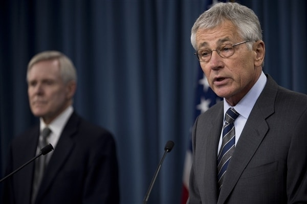 Defense Secretary Chuck Hagel delivers remarks as Navy Secretary Ray Mabus looks on during a briefing at the Pentagon, March 18, 2014 (Photo credit: Erin A. Kirk-Cuomo/DOD)
