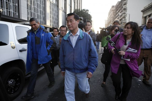 State Sen. Leland Yee is chased by reporters as he leaves the federal building in San Francisco, CA, Wednesday Mar. 26, 2014. Yee is facing charges including weapons violations and wire fraud (Photo credit: Michael Short, The Chronicle)