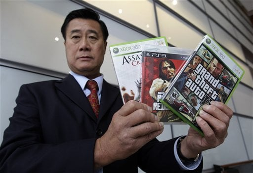 Yee crusaded against violent video games while he visited war zones and the same type of weapons he railed against. (Photo credit: AP)