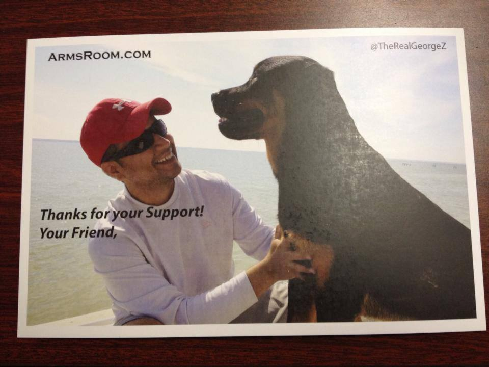 At the event, Zimmerman gave out free autographed pictures of him and his canine companion to supporters. (Photo credit: Facebook)