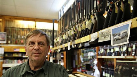 """""""If there's anything in a person's history to indicate potential violence, there should be a restriction put in place,"""" said salesman at Guns Galore, Greg Ebert. (Photo credit: AP)"""