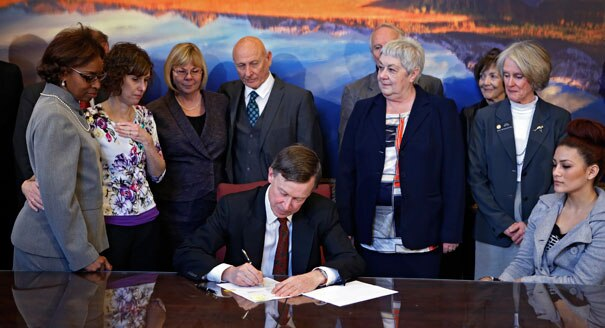 Gov. John Hickenlooper signing new gun legislation
